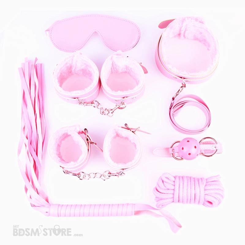 Kit de iniciacion al bdsm rosa con muñequeras y tobilleras, flogger, collar, correa y mordaza más cuerda de algodón